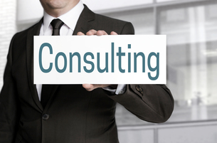 consulting shield is held by businessmanの写真素材 [FYI00661572]
