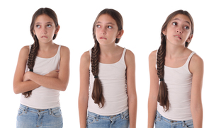 Collage of a young girl bored and angry. Isolatedの写真素材 [FYI00661615]