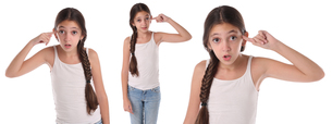 Collage of a young girl doing the crazy sign. Isolatedの写真素材 [FYI00661617]