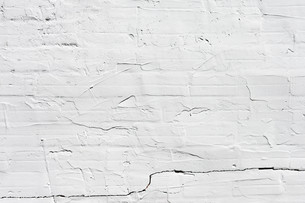 Grungy white concrete wall backgroundの写真素材 [FYI00661859]