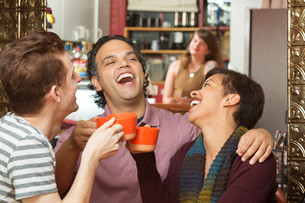 Happy Group with Coffee Cups Laughingの写真素材 [FYI00661911]