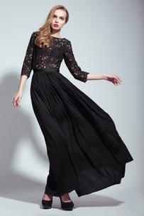 Elegance. Young Fashion Model in Black Dressの写真素材 [FYI00661957]