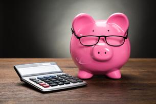 Piggybank With Calculatorの写真素材 [FYI00662087]