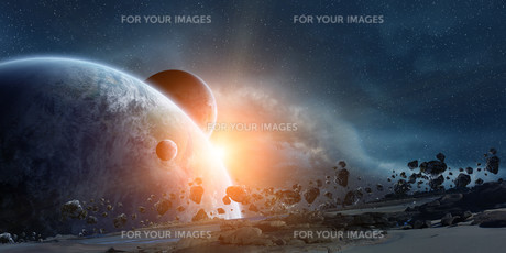Sunrise over planet Earth in spaceの写真素材 [FYI00662252]