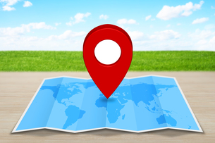 Pin map icon?on a blue mapの写真素材 [FYI00662253]