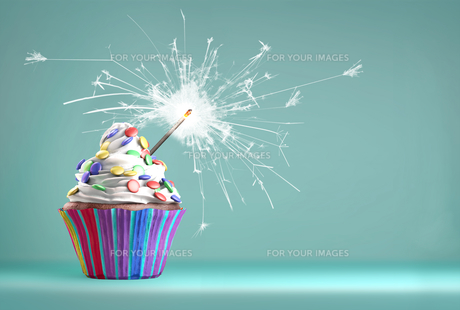 Delicious cupcake with a sparkler for an event celebration.の写真素材 [FYI00662542]