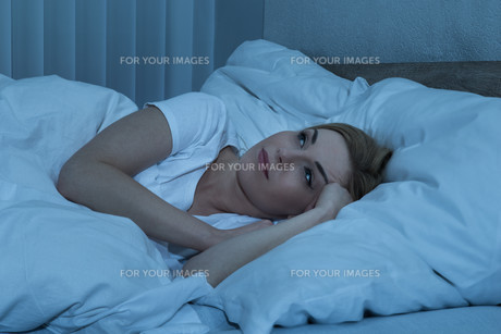 Woman In Bed Suffering From Insomniaの写真素材 [FYI00662757]