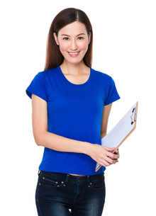 Young woman holding with document workの写真素材 [FYI00662868]
