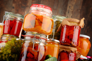 Jars with pickled vegetables and fruity compotesの写真素材 [FYI00662997]