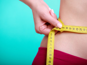 diet. fitness woman fit girl with measure tape measuring her waistの写真素材 [FYI00663224]