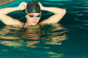 woman athlete in swimming pool water. sports.の写真素材 [FYI00663322]