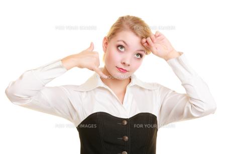 phone. surprised businesswoman making call me gestureの素材 [FYI00663327]