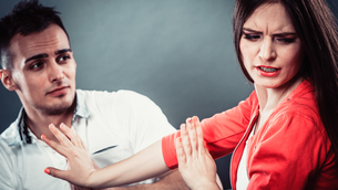 husband apologizing wife. angry upset woman.の写真素材 [FYI00663331]