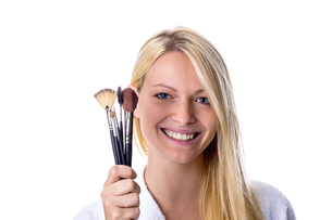 young woman with makeup brush in handの写真素材 [FYI00663346]