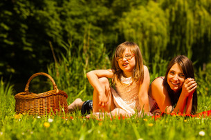 mother and daughter on picnic. summer leisure.の写真素材 [FYI00663349]