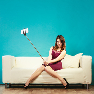 girl taking a self picture selfie with smartphone cameraの写真素材 [FYI00663361]