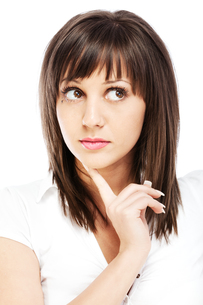 Young woman thinkingの写真素材 [FYI00663366]