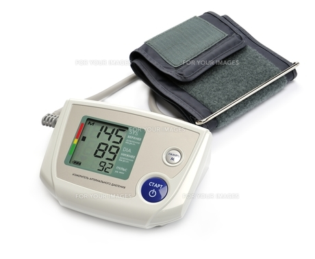 Tonometer - Digital blood pressure monitor on white backgroundの写真素材 [FYI00663629]