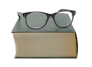 Glasses lie on the bookの写真素材 [FYI00663630]