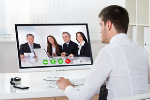 Businessman Videoconferencing On Desktop Computerの写真素材 [FYI00664178]