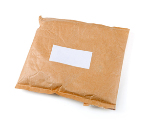small paper post parcel with blank labelの写真素材 [FYI00664196]