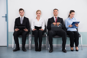 Businesspeople Sitting On Chair For Giving Interviewの写真素材 [FYI00664351]