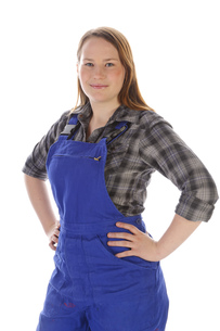young woman,girl in blue overalls,proudの写真素材 [FYI00667674]