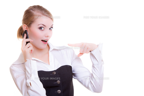 surprised businesswoman pointing phone. business communication.の写真素材 [FYI00669110]