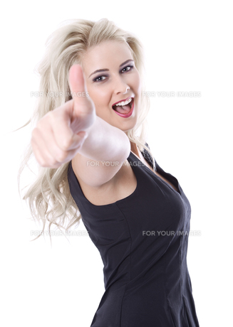young blonde woman isolated - excited and successfully with thumbs upの写真素材 [FYI00669802]