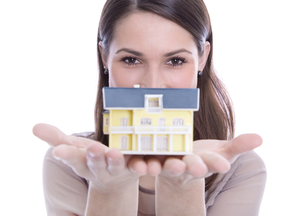the dream of home ownership - woman with a property isolatedの写真素材 [FYI00669803]