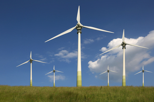 windmills in a meadow on energy and environmental protectionの写真素材 [FYI00670496]