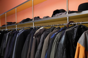 many clothes in cloakroomの写真素材 [FYI00671402]