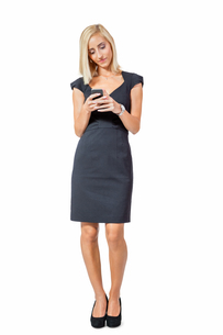 young attractive businesswoman with smartphoneの写真素材 [FYI00673108]