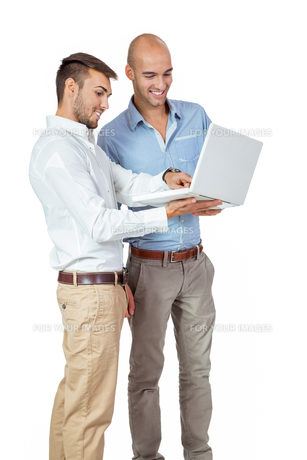 two young adult businessmen with laptopの素材 [FYI00673112]