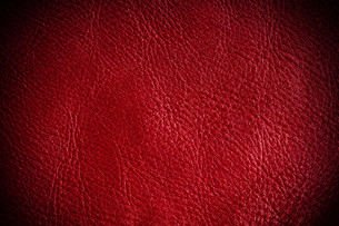 red grunge textured leather background closeupの写真素材 [FYI00674678]