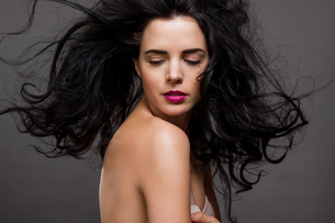 hair young attractive woman with red lips and dark curlyの写真素材 [FYI00675454]