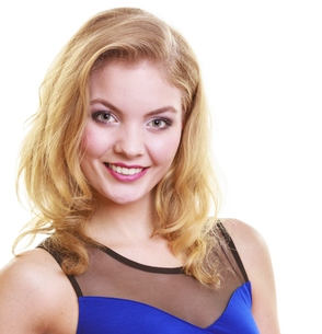 beautiful blond girl in sexy deep blue dress isolatedの写真素材 [FYI00675525]