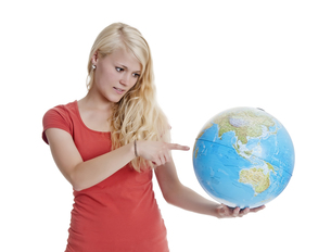 woman with globeの写真素材 [FYI00676442]