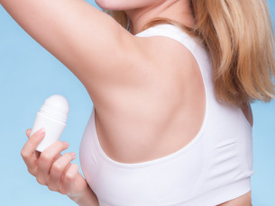girl applying deodorant stick in the armpit. skin careの写真素材 [FYI00679402]
