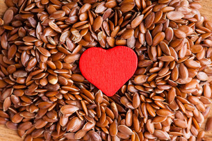 healthy diet. flax seeds linseed as food background and red heartの写真素材 [FYI00680028]