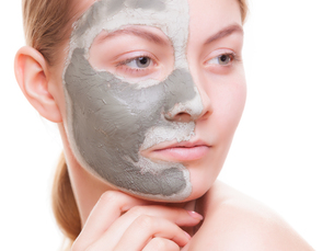 skin care. woman applying clay mask on face. spa.の写真素材 [FYI00681179]