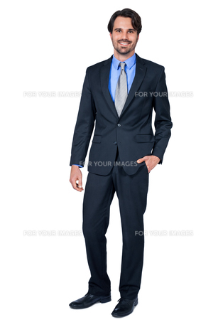 selbstbewuster young businessman with suit dark hair and beardの写真素材 [FYI00681386]
