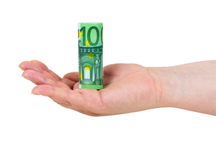 hand holding rolled 100 euro banknoteの写真素材 [FYI00683260]
