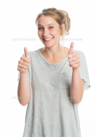 blonde girl shows thumbs upの素材 [FYI00683326]