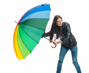 young woman with umbrellaの素材 [FYI00683364]