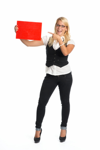 blond woman holding advertising signの写真素材 [FYI00683412]