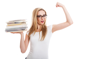 young blonde woman with long blond hair with a pile of books in her armsの写真素材 [FYI00683426]