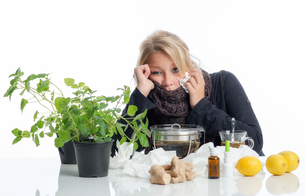 sick blond woman with remediesの写真素材 [FYI00683441]