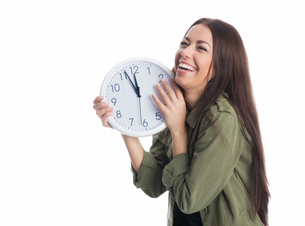 laughing woman with clockの写真素材 [FYI00683607]