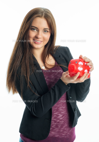 young girl with piggy bankの写真素材 [FYI00684096]